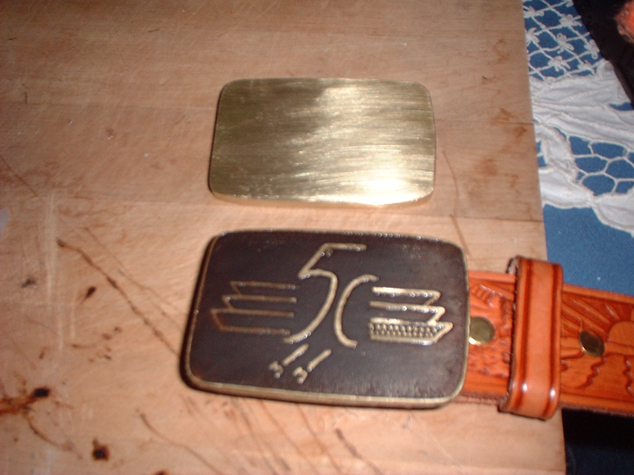 The etched buckle after being darkened (antiqued).